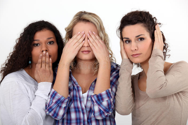 Young women. Four young women witnessing destruction stock photography