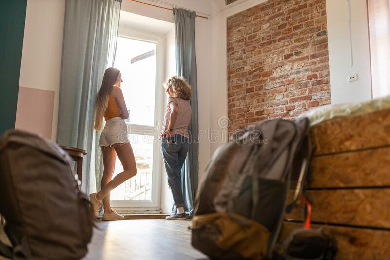 Young female tourists staying in youth hostel stock photography