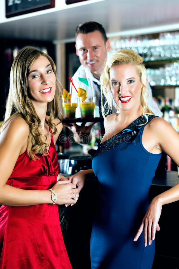 Download Young Women And Bartender In Club Or Bar Stock Photography - Image: 28557842