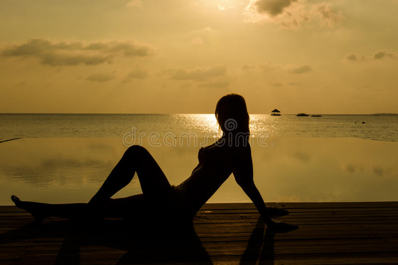Young women on the beach royalty free stock images