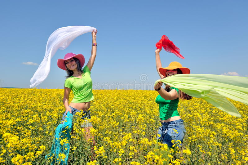 Download Young Women On Blooming Field In Summer Stock Photo - Image: 13396938