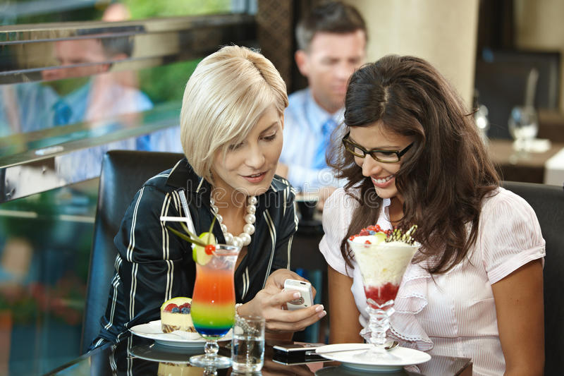 Young women in cafe royalty free stock photography