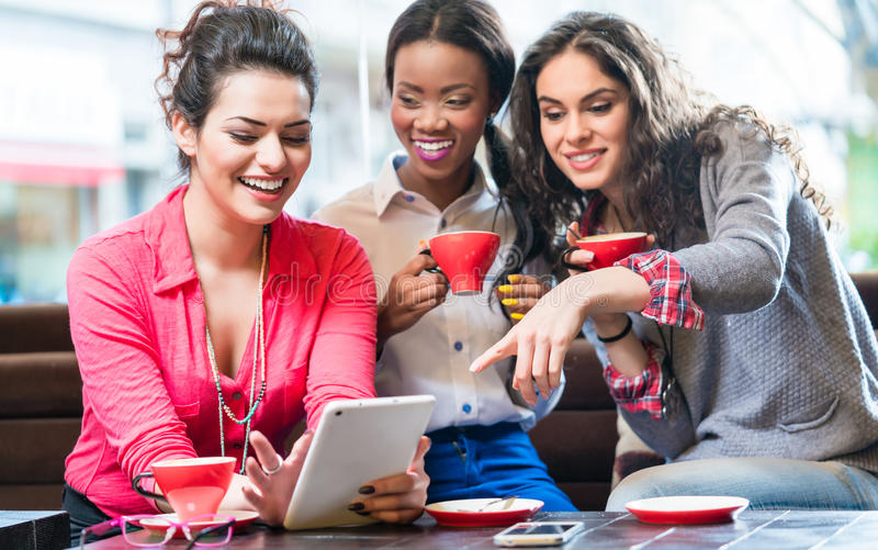 Young women in cafe taking selfie stock photography