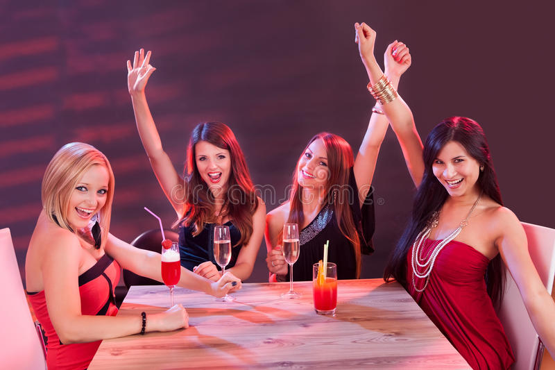 Young women celebrating in a nightclub stock photos