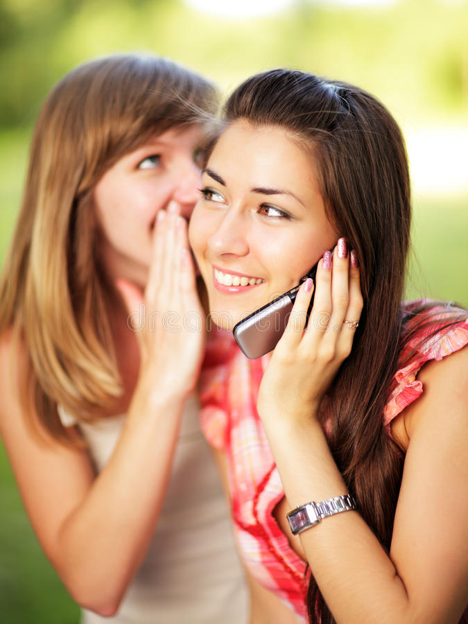 Young women on cell phone. stock image