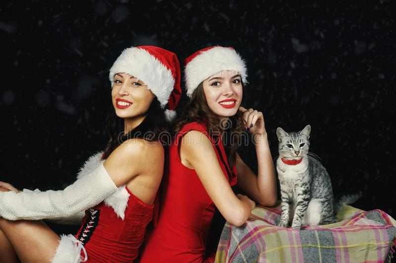 Young women in Christmas outfits royalty free stock photography