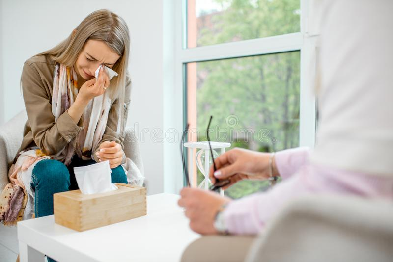 Woman crying during the psychological counseling stock image