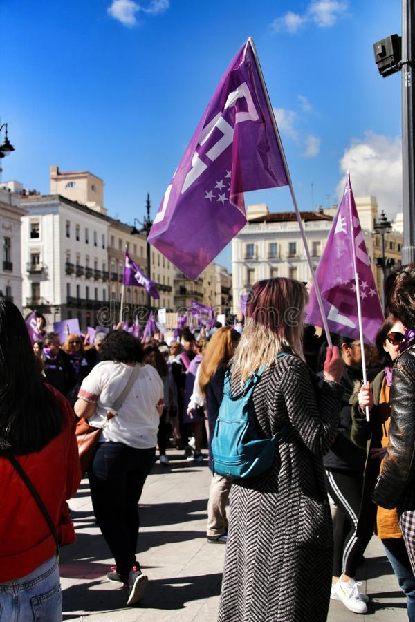 Young women demonstrating for International Women& x27;s Day. Madrid, Spain-March 8, 2019: Young women demonstrating with feminist banners and symbols in Madrid stock photos