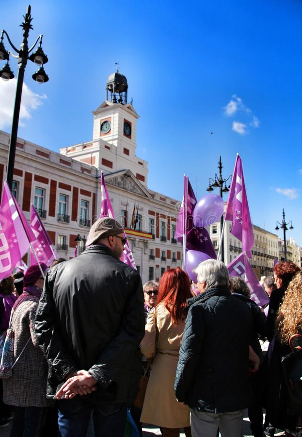 Young women demonstrating for International Women& x27;s Day. Madrid, Spain-March 8, 2019: Young women demonstrating with feminist banners and symbols in Madrid royalty free stock photography