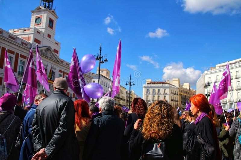 Young women demonstrating for International Women& x27;s Day. Madrid, Spain-March 8, 2019: Young women demonstrating with feminist banners and symbols in Madrid stock photo