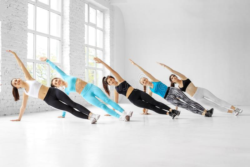 Young women do aerobics in the dance class. The concept of sports, a healthy lifestyle, fitness, stretching. And dancing royalty free stock photo