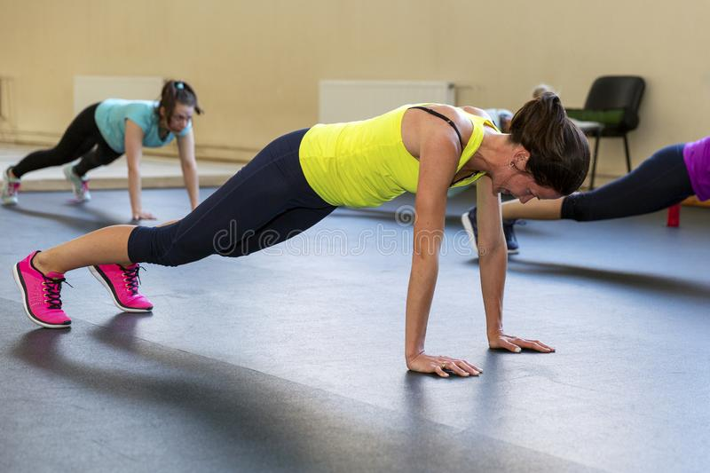 Young women do aerobics in the gym. Horizontal royalty free stock image
