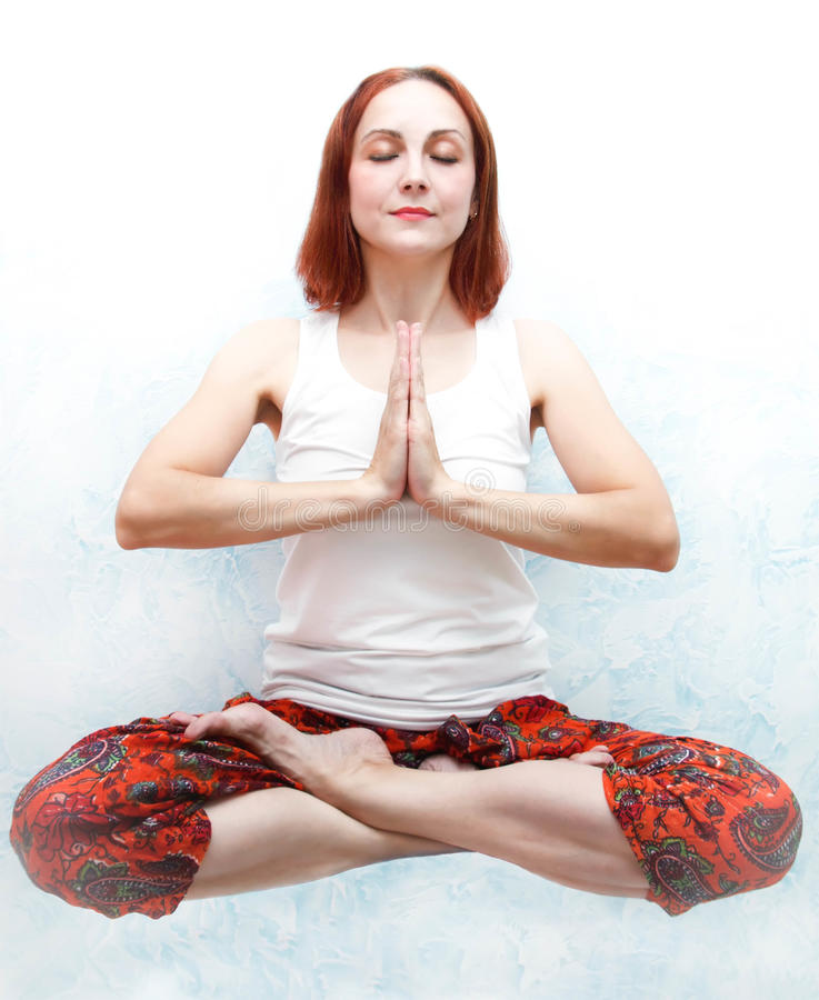 Young women do yoga indoors royalty free stock images