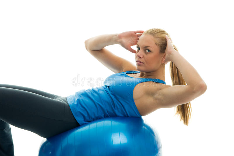 Young Women Doing Crunches On Fitness Ball Royalty Free Stock Images
