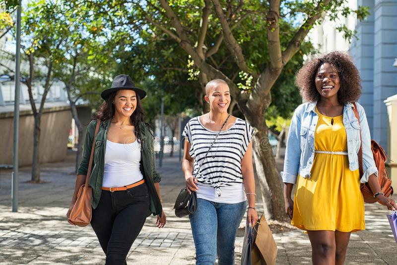 Young women doing shopping on street stock images