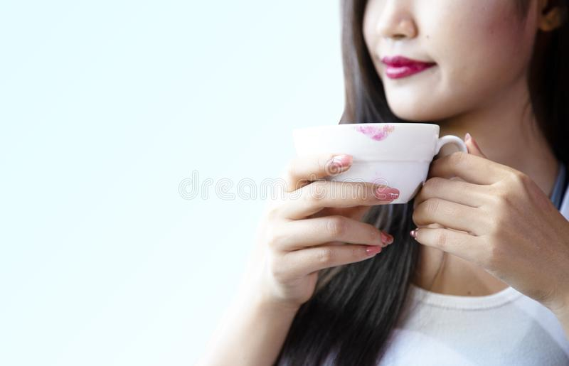 Young women are drinking hot coffee happily royalty free stock photography