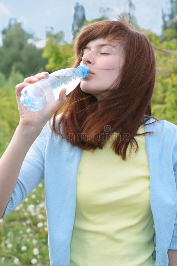 Young Women Drinks Water Royalty Free Stock Images