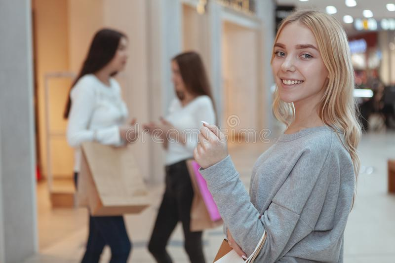 Young women enjoying shopping together at the mall stock photos