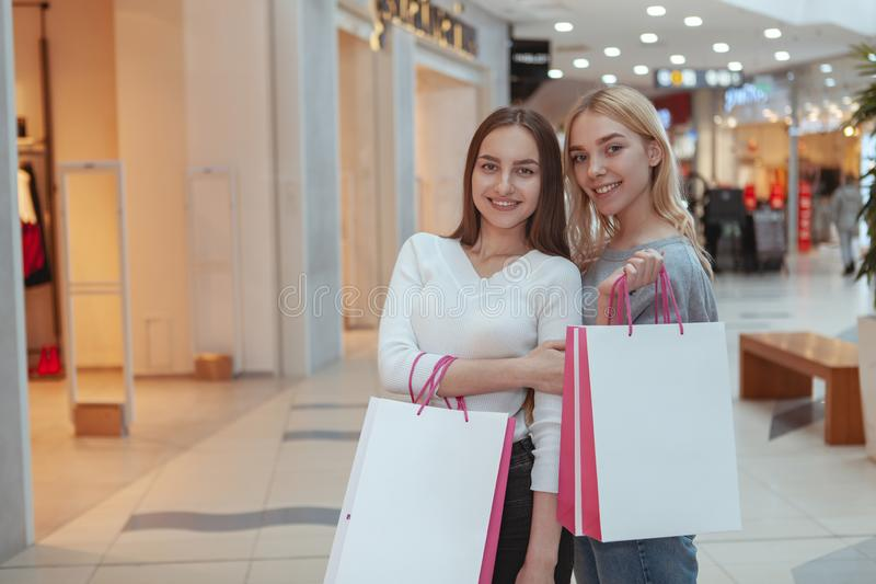 Young women enjoying shopping together at the mall royalty free stock images
