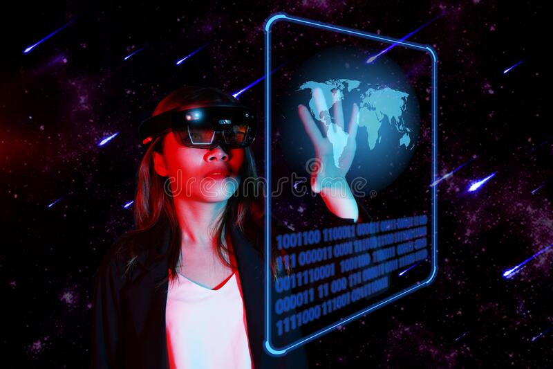 Young women entrpreneur control the advanced technology in AR VR galaxy world. Mixed reality concept. stock images