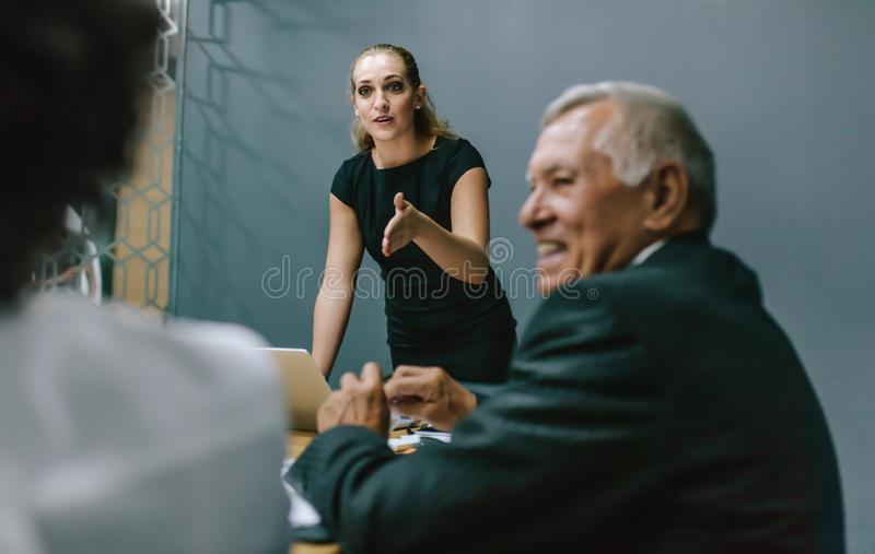 Businesswoman leading a meeting in office royalty free stock photo