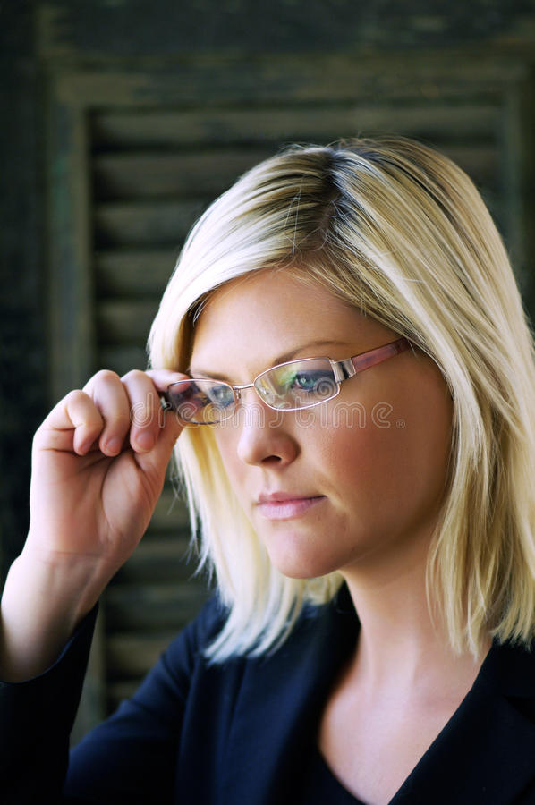 Young women with eyeglasses stock images