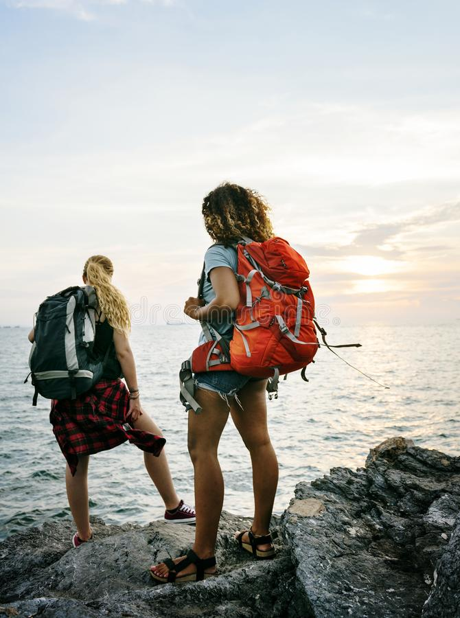 Young women friends traveling together stock photography