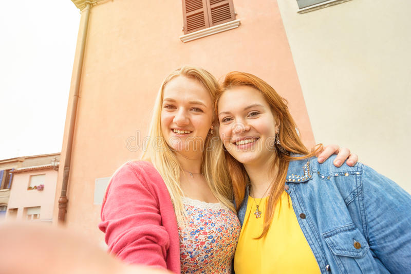 Young women girlfriends taking selfie and having fun royalty free stock photography
