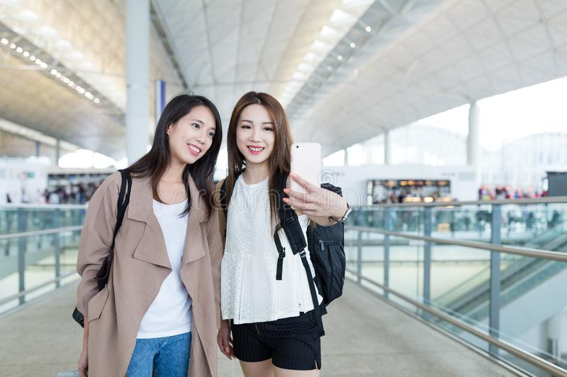 Young women go travel together and taking selfie in Hong Kong ai. Rport, ,asian young woman royalty free stock image