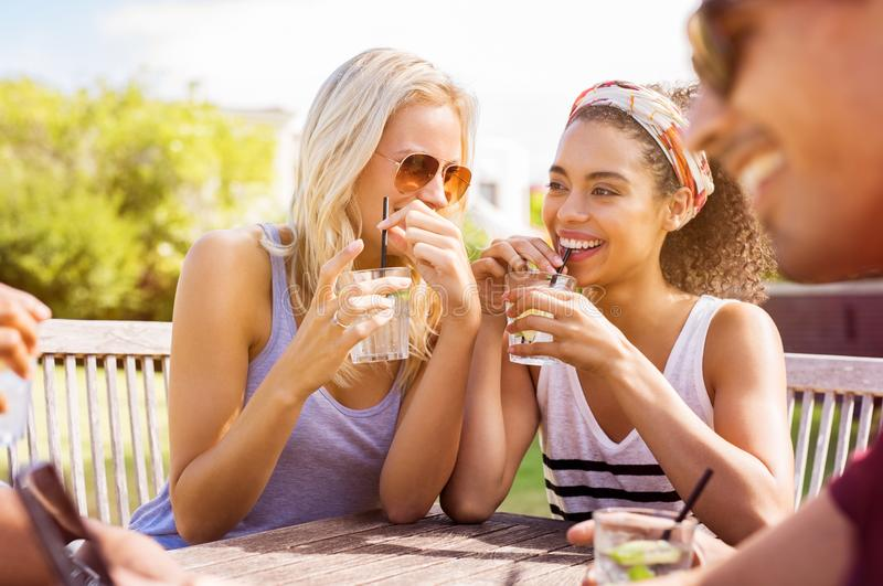 Women talking and drinking stock photos