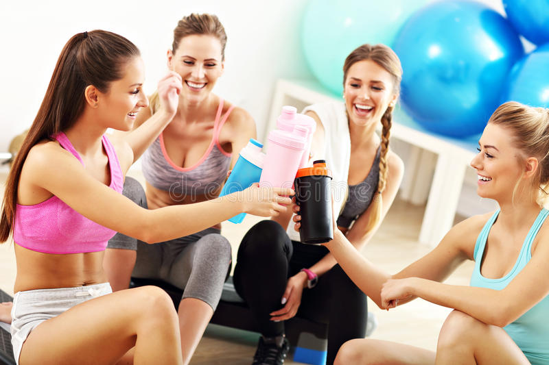 Young women group resting at the gym after workout royalty free stock images