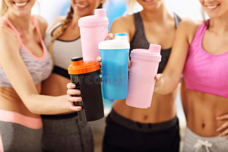 Young women group resting at the gym after workout stock photography