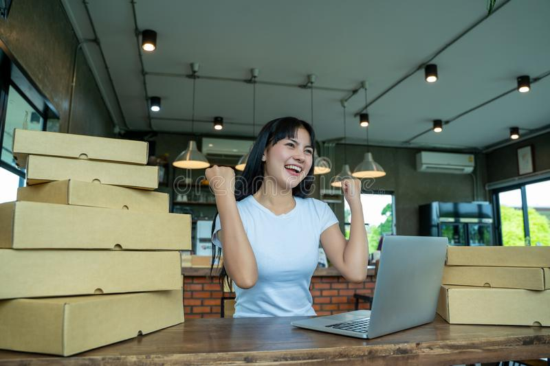 Young Women happy after new order from customer,business owner working at home office packaging on background,online sales. stock photo
