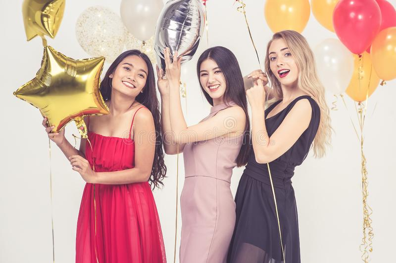 Young women have fun together at party royalty free stock photo