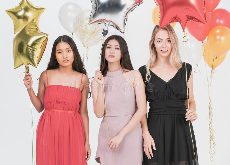Young women have fun together at party royalty free stock images