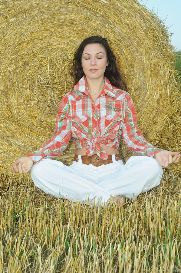 Young women have relaxation and balance with nature. Young woman have relaxation and balance with nature in the field at the sunrise stock image