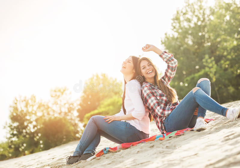 Young women having fun outdoors on the beach stock photography