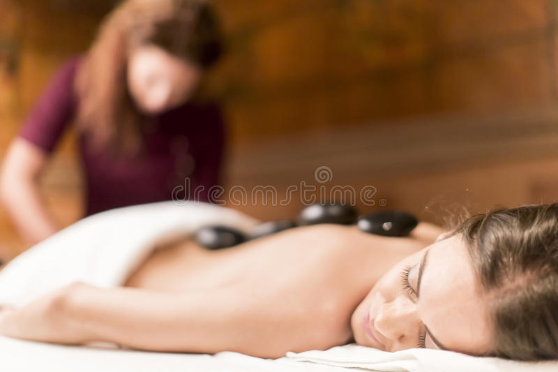 Spa hot stone massage stock image