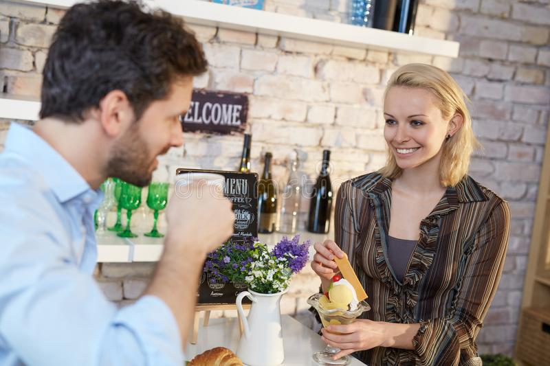 Happy couple in cafeteria royalty free stock photography