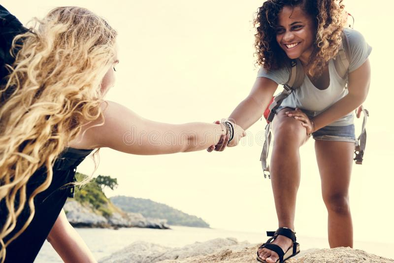 Young women helping each other stock image