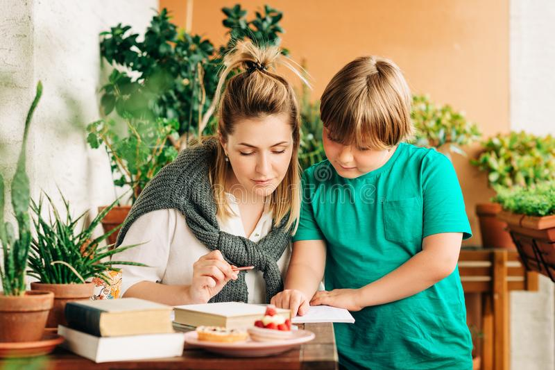 Young woman helping little boy royalty free stock image