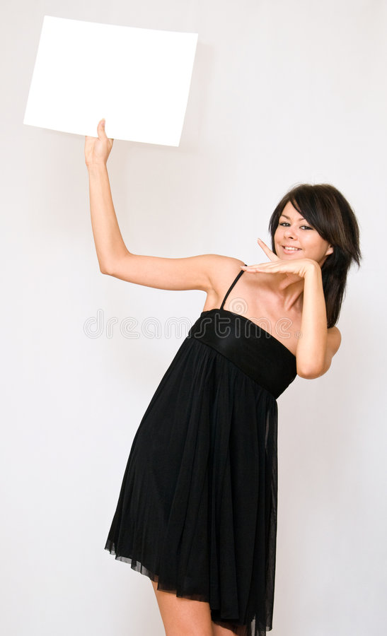 Young women holding blank paper royalty free stock image