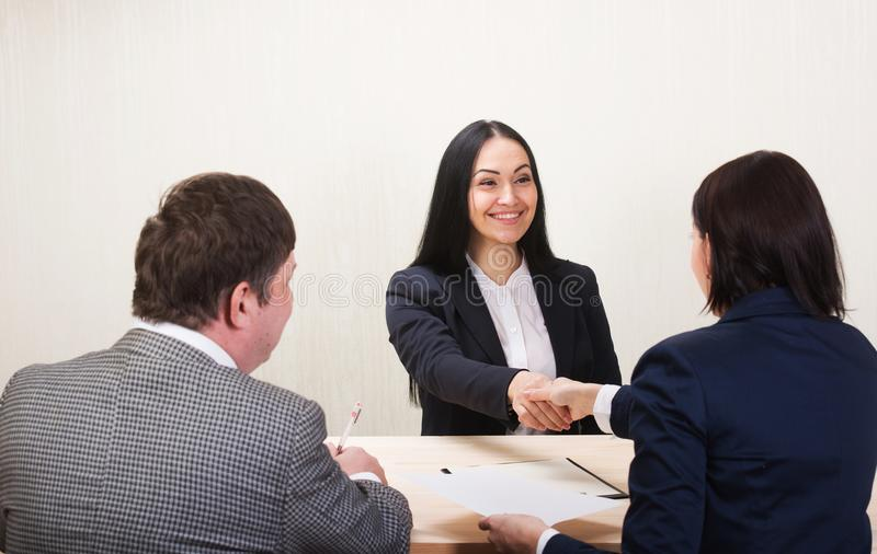Young woman during job interview and members of managemen. royalty free stock images