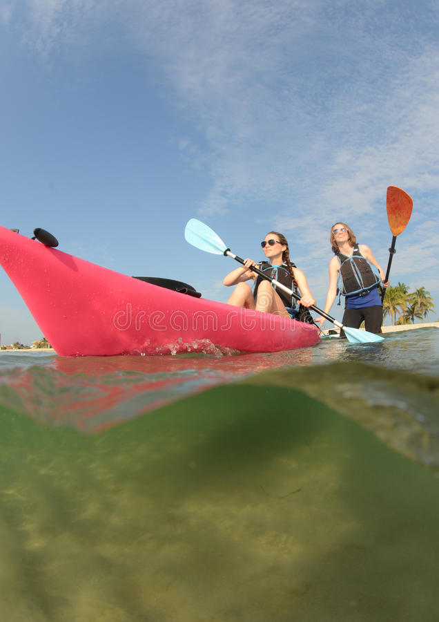 Young women and kayak in florida royalty free stock images