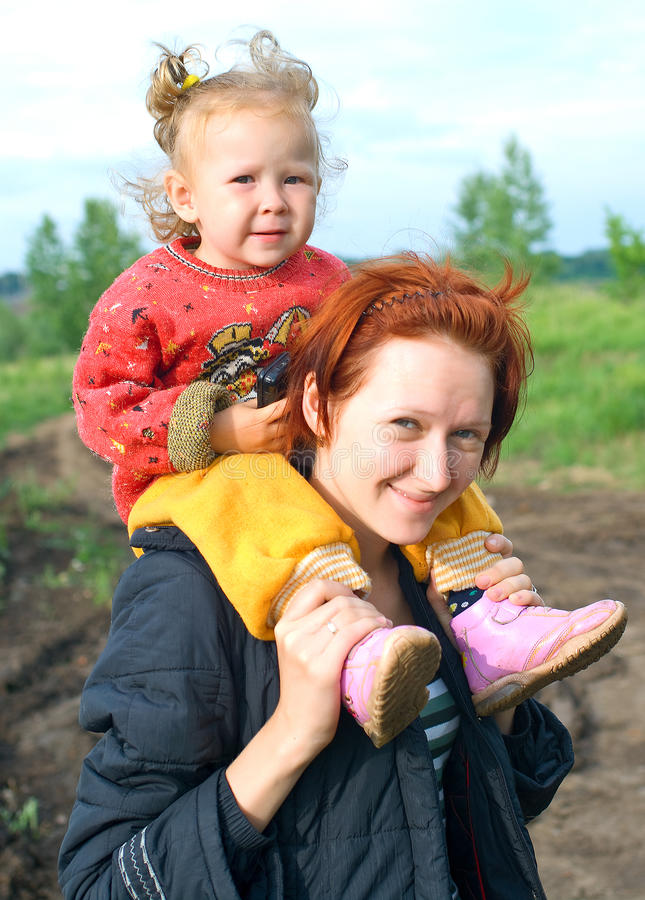Young women with a little child stock images