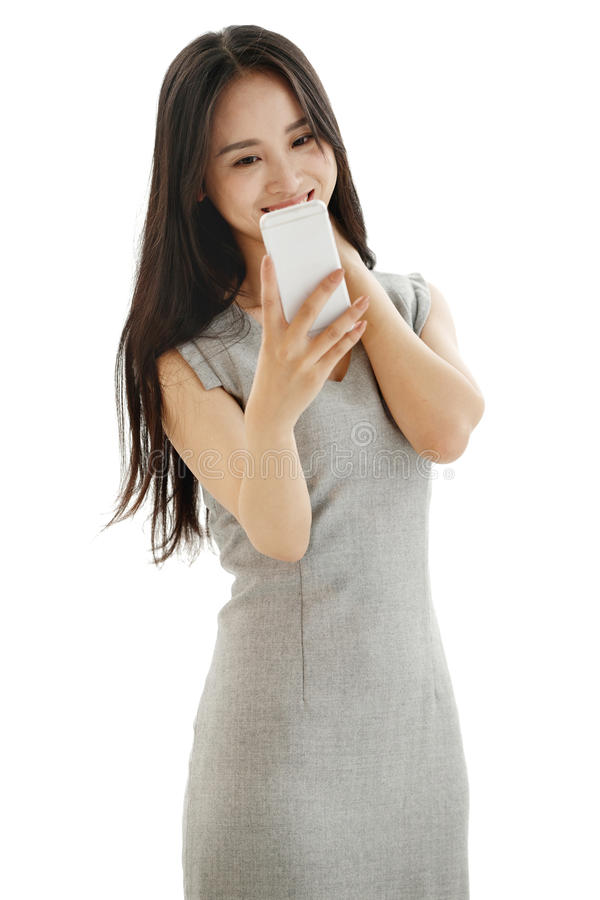 Young women look at mobile phones. Young business woman isolated on white royalty free stock photography