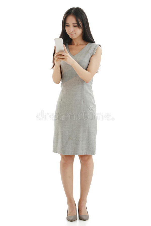 Young women look at mobile phones. Young business woman isolated on white royalty free stock photo