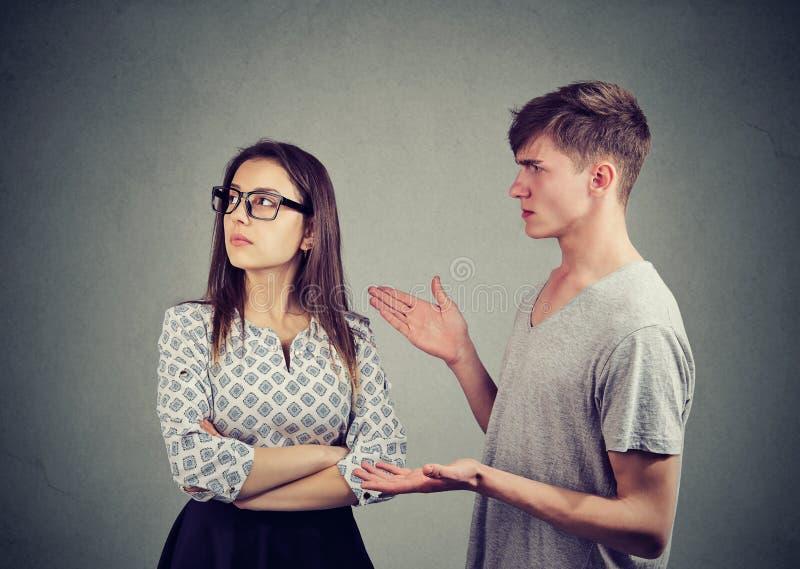 Disputing young couple having quarrel royalty free stock images