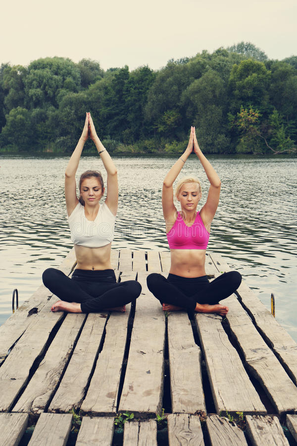Young women in the lotus position royalty free stock photo