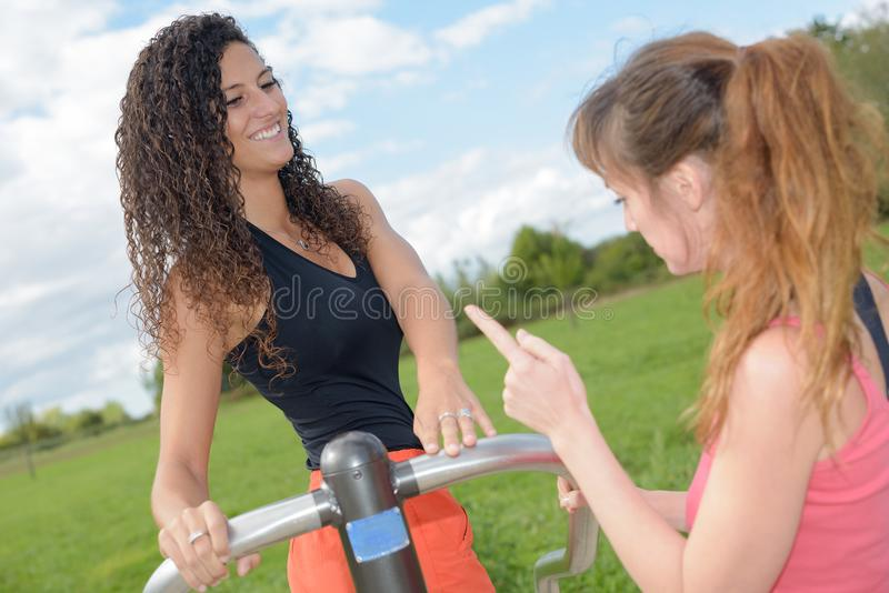 Young women making exercise in park stock photography